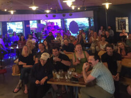 Group of people attending comedy event at Greater Purpose Brewery